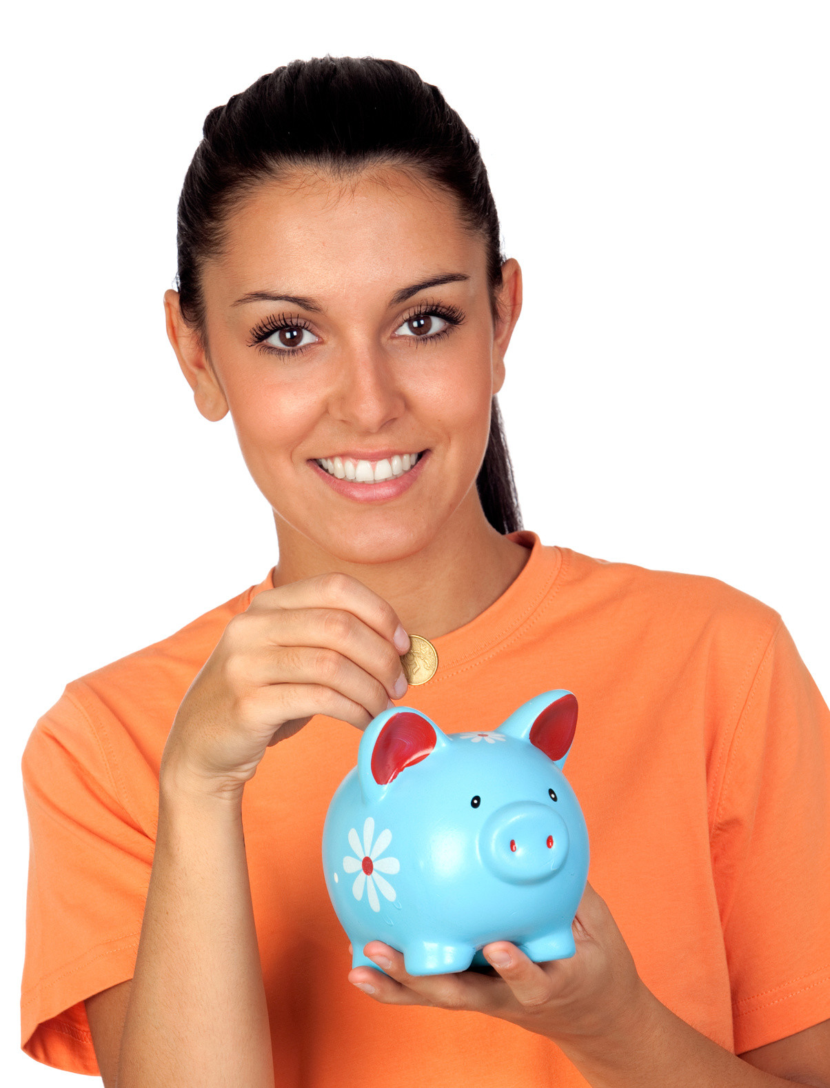 Pretty brunette woman inserting a coin in a piggy-bank